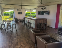 Coteva outdoor custom display with rental furniture